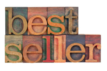 bestseller - word in vintage wood letterpress type blocks stained by color inks, isolated on white